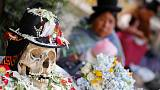 Bolivians turn to Day of Skulls for hope as protests rage