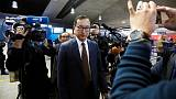 Cambodian opposition figure Sam Rainsy boards plane in Paris