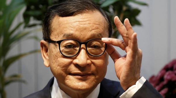 Cambodian opposition figure Sam Rainsy taken aside by Malaysian immigration officials
