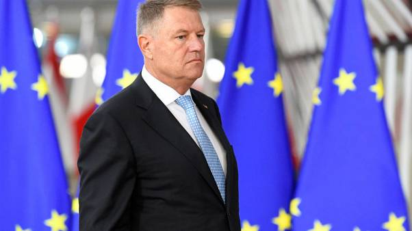 Romania's Iohannis wins first round of presidential vote as turnout nears 50%