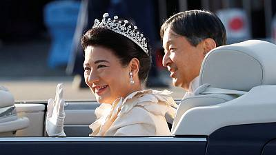 Japan imperial couple rides through Tokyo in grand enthronement parade