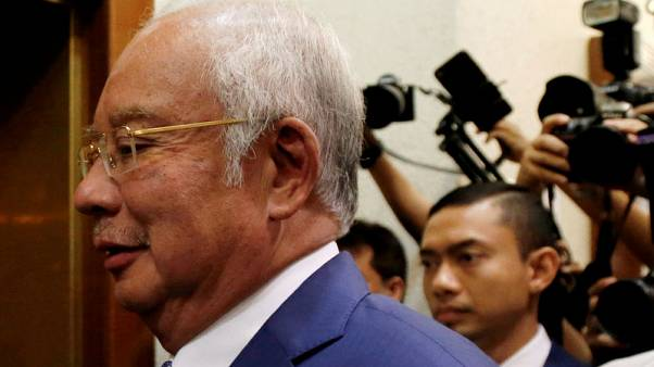Malaysian court tells former PM Najib to defend himself in 1MDB-linked case