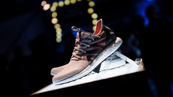 Adidas to close German, U.S. robot factories