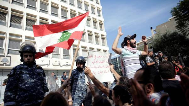 Lebanon central bank says bank deposits are safe, banks to review curbs