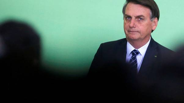 Brazil's Bolsonaro to quit divided PSL party, found new one