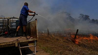 Australians shelter and flee as firefighters battle 150 bushfires