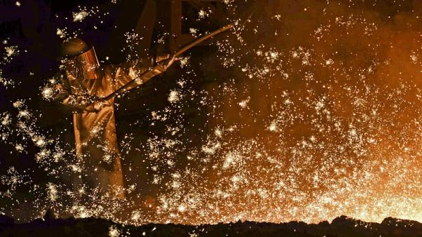 Euro zone industry output nudges up against expectations