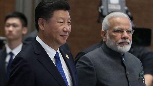 Despite Kashmir anger, China's Xi invites India's Modi to visit again next year
