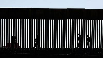 Some migrants waiting in Mexico for U.S. court hearings caught crossing illegally