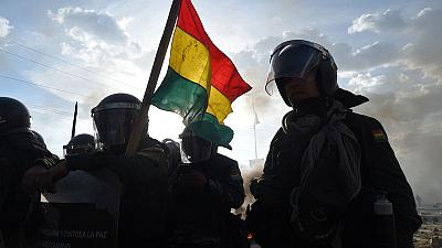 Bolivian police battle with Morales supporters, death toll jumps