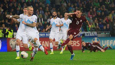Own goal keeps Slovenia's faint hopes alive