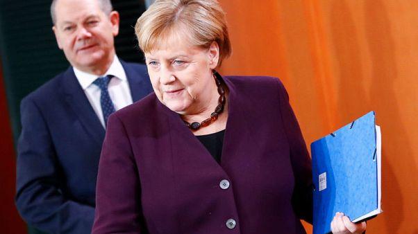 Merkel, Scholz push back against demands for higher public spending