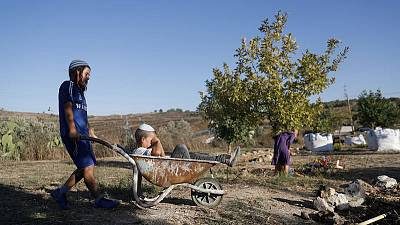 Israel's settlers and the Palestinians they live among