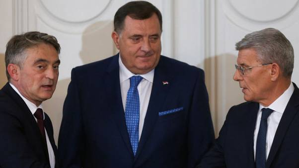 Bosnia names Serb as prime minister after compromise on NATO