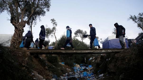 Struggling with influx, Greece gets tough with asylum seekers