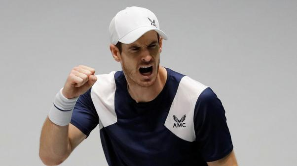 Murray claws out victory to give Britain lead, Serbia win