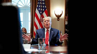 Trump says U.S., China trade talks continue