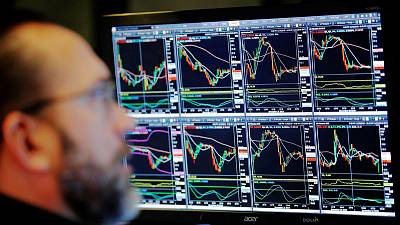 Global stocks slip, dollar rebounds on trade hopes stir sentiment