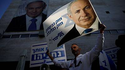 Israel's Netanyahu faces calls to quit but is defiant in crisis
