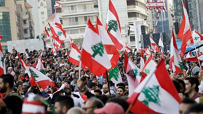 Lebanese protesters pack streets to mark independence day