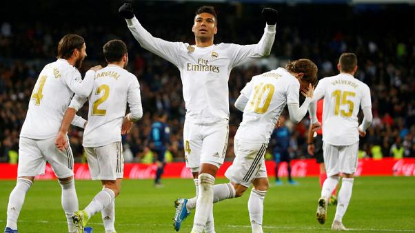Real Madrid recover from Ramos blunder to keep pace with Barca