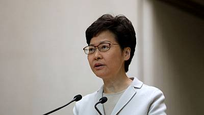 Hong Kong leader thanks residents for orderly voting despite volatile environment