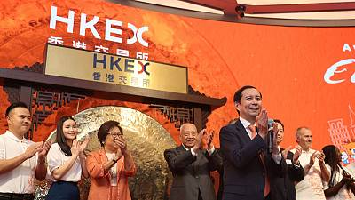 Alibaba's Hong Kong shares mark maiden day of trade with small premium to New York