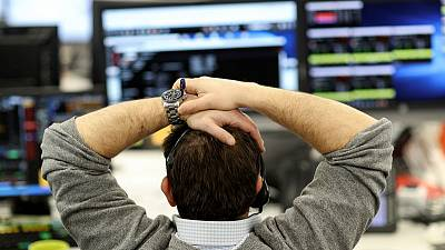 Compass drop weighs on FTSE, trade hopes soften blow