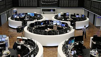 European shares calm as investors seek any signs of trade deal progress