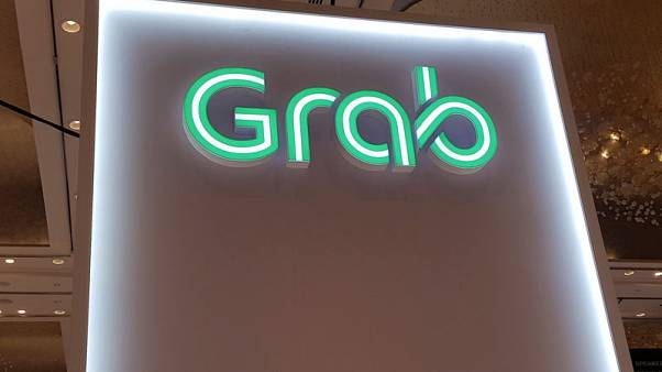 Singapore's Grab launches pilot motorbike-hailing service in Malaysia