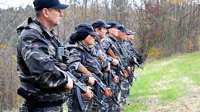 Slovenia backs ban on paramilitary groups after militia patrol border