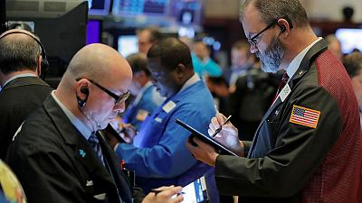 Stocks near record highs on trade hopes, dollar gains