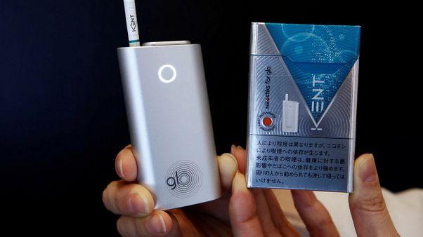 British American Tobacco raises full-year revenue target
