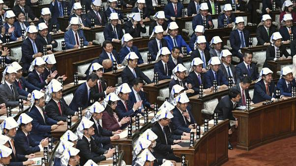Japan MPs' disaster helmet drill sparks Twitter debate