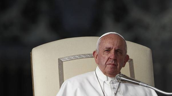 Pope names new financial regulator following police raid
