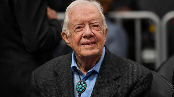 Former U.S. President Carter home for the holidays after surgery