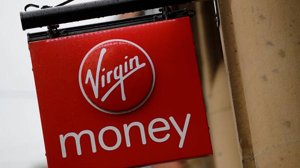 Virgin Money UK posts lower annual profit, cancels dividend