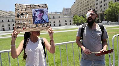 Chileans suffering eye trauma from protests march on presidential palace