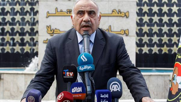 Iraq PM says he will quit after cleric's call but violence rages on