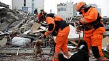 Rescue workers comb ruins of hotel for Albanian quake survivors