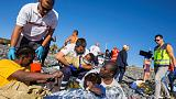 Sunbathers join rescue as migrant boat washes up on Canary Islands beach