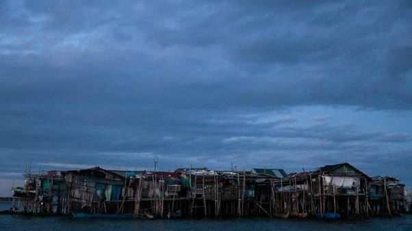 Rising seas threaten early end for sinking village in Philippines