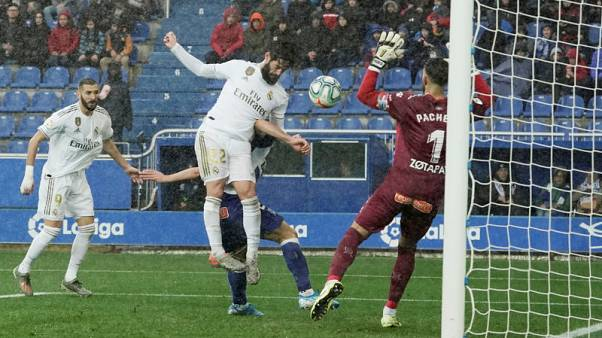 Real Madrid dig deep to see off Alaves and go top