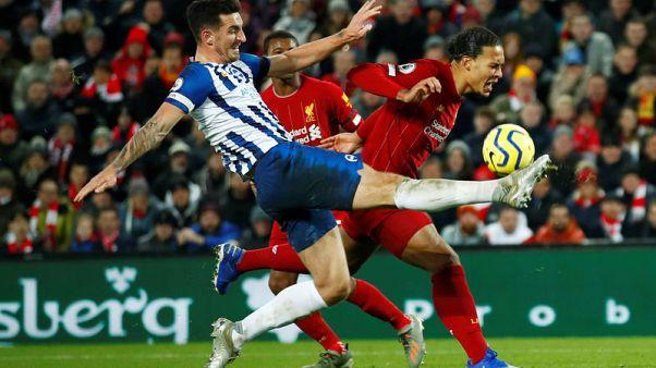 Van Dijk nets double as Liverpool surge 11 points clear