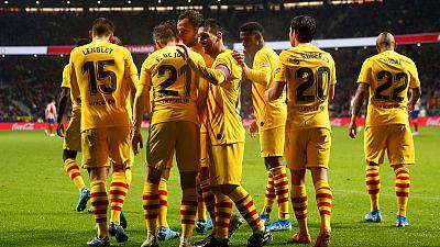 Magical Messi sinks Atletico as Barca return to the top