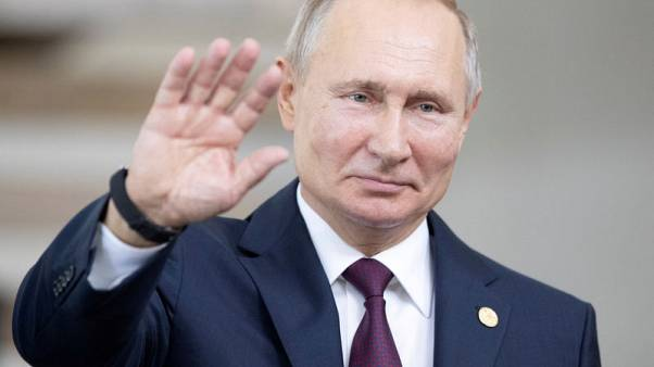 Russia's Putin signs law to label people foreign agents
