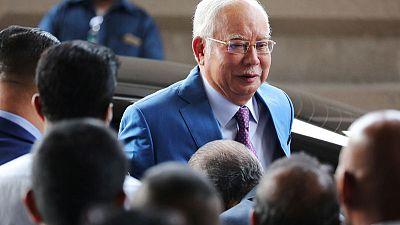Former Malaysian PM Najib takes stand in 1MDB scandal-linked trial