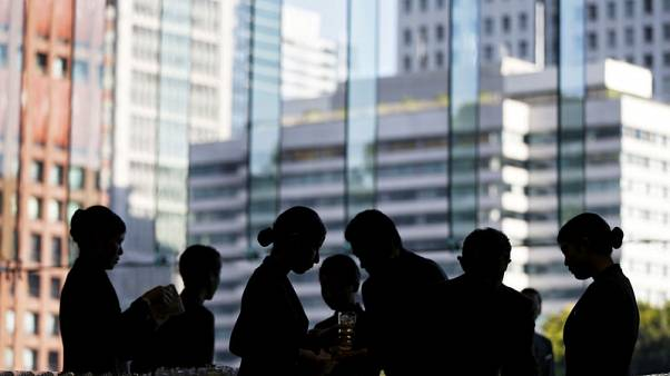Japan services sector returns to modest growth in November - PMI