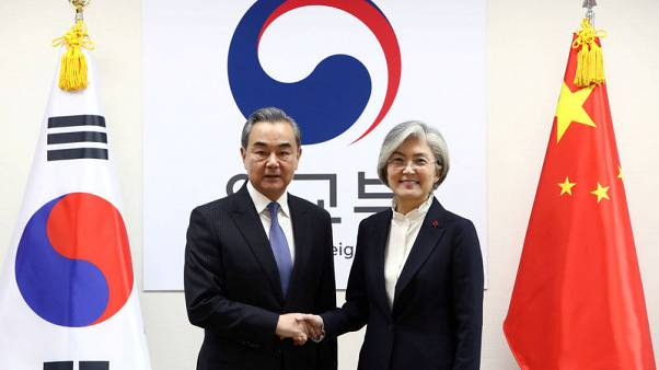 South Korea, China agree to step up exchanges to re-set ties after missile defence row