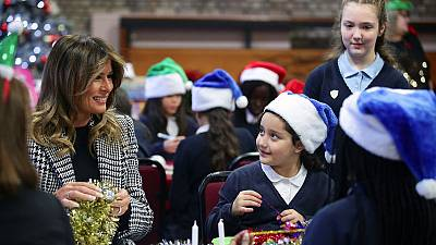 Melania Trump hands out Christmas presents to London children